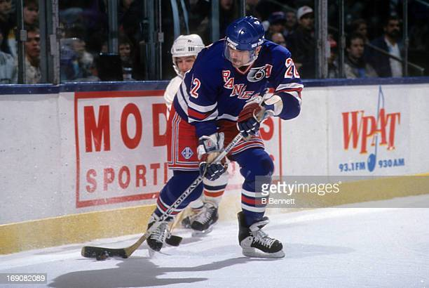 Mike Gartner of the New York Rangers battles for the puck during an NHL game against the New York Islanders on December 28 1991 at the Nassau...