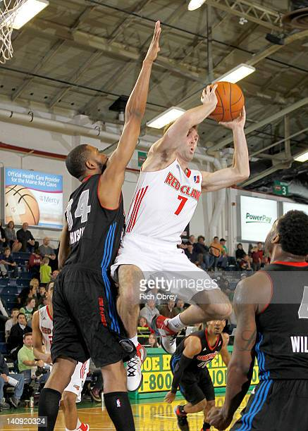 Mike Gerrity of the Maine Red Claws looks to pass after being stopped on a drive by Damian Johnson of the Springfield Armor during the game on March...