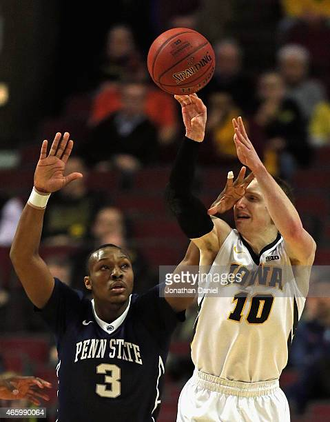 Mike Gesell of the Iowa Hawkeyes passes as Devin Foster of the Penn State Nittany Lions gets a hand in his face during the second round of the 2015...