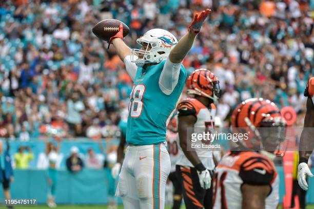 Mike Gesicki of the Miami Dolphins celebrates after scoring his second touchdown of the game against the Cincinnati Bengals at Hard Rock Stadium on...