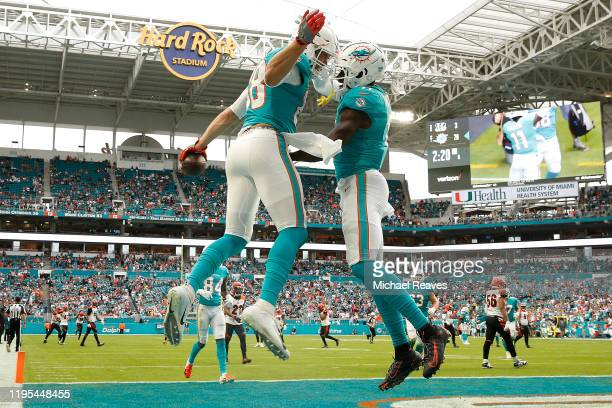 Mike Gesicki of the Miami Dolphins celebrates with DeVante Parker after a touchdown against the Cincinnati Bengals during the second quarter at Hard...