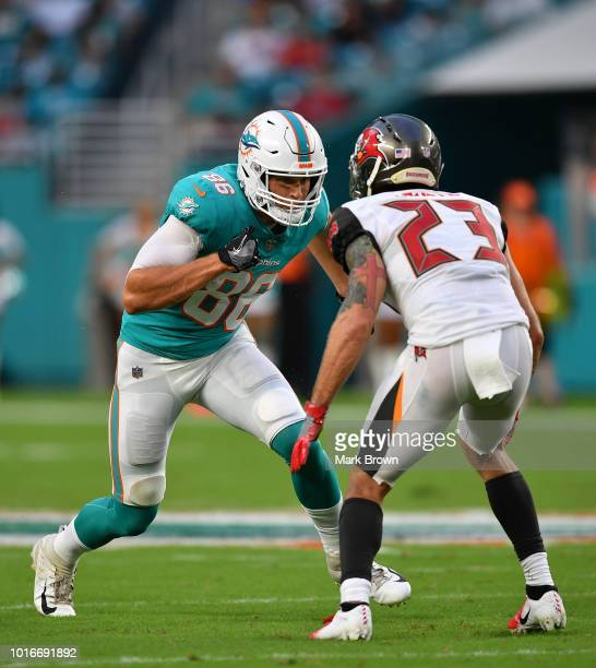 Mike Gesicki of the Miami Dolphins lines up to run a route against Chris Conte of the Tampa Bay Buccaneers in the first quarter during a preseason...