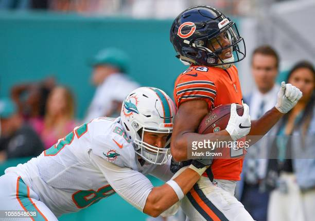 Mike Gesicki of the Miami Dolphins tackles Kyle Fuller of the Chicago Bears during the game between the Miami Dolphins and the Chicago Bears at Hard...