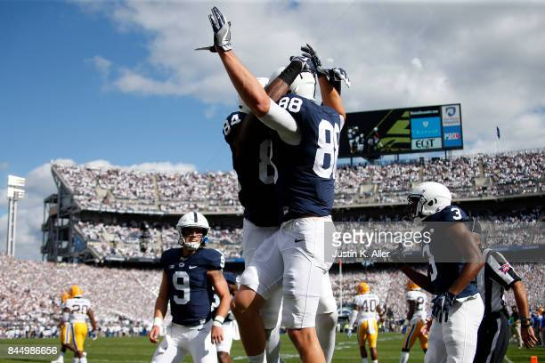 Mike Gesicki of the Penn State Nittany Lions celebrates after catching a 10 yard touchdown pass in the first half against the Pittsburgh Panthers at...