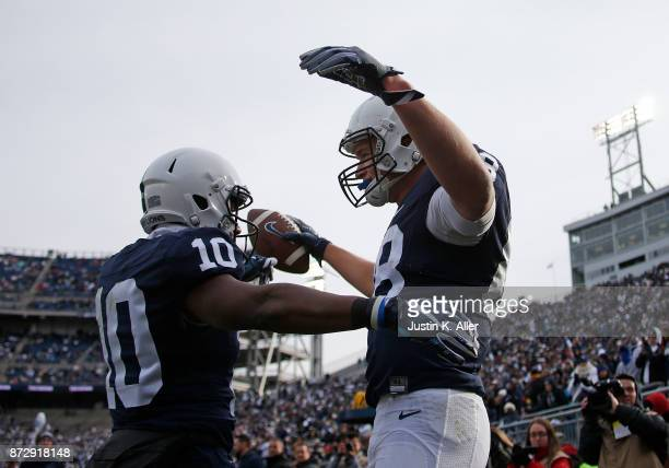 Mike Gesicki of the Penn State Nittany Lions celebrates after catching a 16 yard touchdown pass in the fourth quarter against the Rutgers Scarlet...