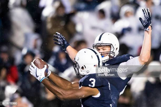 Mike Gesicki of the Penn State Nittany Lions congratulates DeAndre Thompkins for a touchdown reception against the Nebraska Cornhuskers on November...