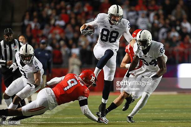Mike Gesicki of the Penn State Nittany Lions leaps over Saquan Hampton of the Rutgers Scarlet Knights during the first half at High Point Solutions...