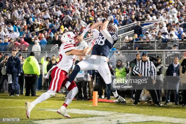 Mike Gesicki of the Penn State Nittany Lions makes a leaping touchdown reception above the hands of Chris Weber of the Nebraska Cornhuskers during...