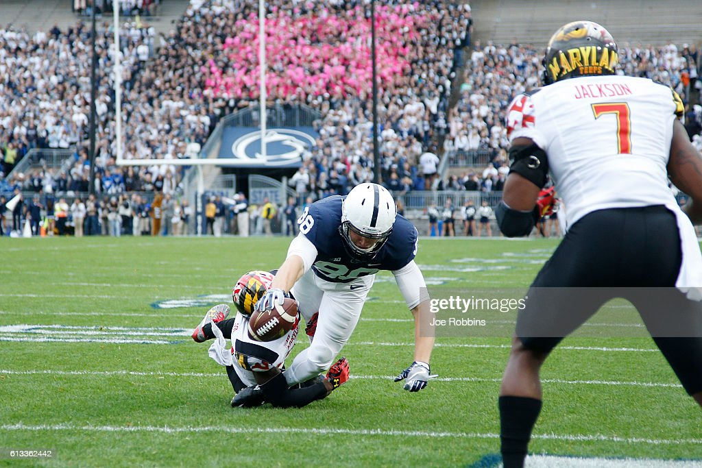 Mike Gesicki #88 of the Penn State Nittany Lions reaches the ball over the goal line for a five-yard touchdown in the first quarter against the Maryland Terrapins at Beaver Stadium on October 8, 2016 in State College, Pennsylvania.