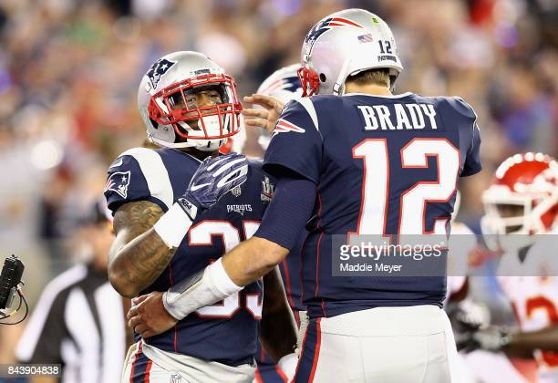 Mike Gillislee celebrates with Tom Brady of the New England Patriots after scoring a touchdown during the first quarter against the Kansas City...