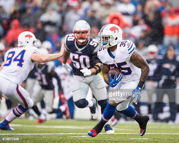 Mike Gillislee of the Buffalo Bills carries the ball during the first half against the New England Patriots on October 30, 2016 at New Era Field in...