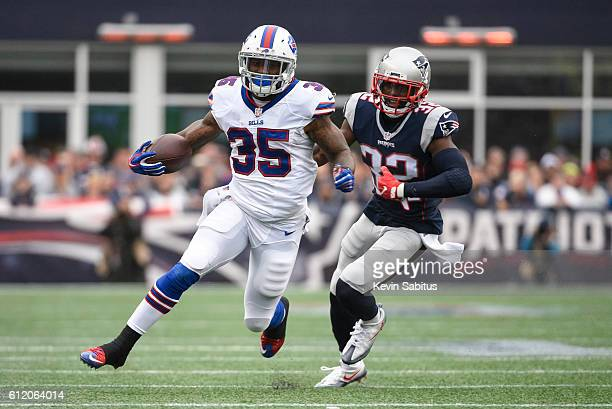 Mike Gillislee of the Buffalo Bills carries the ball past Devin McCourty of the New England Patriots in the first quarter at Gillette Stadium on...