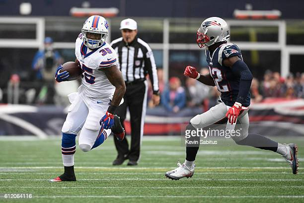 Mike Gillislee of the Buffalo Bills carries the ball up the field in the first quarter against the New England Patriots at Gillette Stadium on...