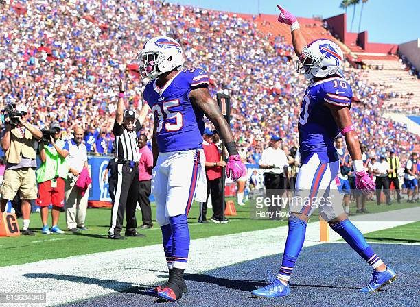 Mike Gillislee of the Buffalo Bills celebrates a touchdown in the end zone with teammate Robert Woods during the second quarter of the game against...