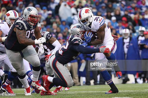 Mike Gillislee of the Buffalo Bills is tackled for a loss against New England Patriots during the second half at New Era Field on October 30, 2016 in...