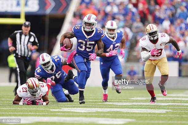 Mike Gillislee of the Buffalo Bills runs for a touchdown against the San Francisco 49ers during the second half at New Era Field on October 16 2016...
