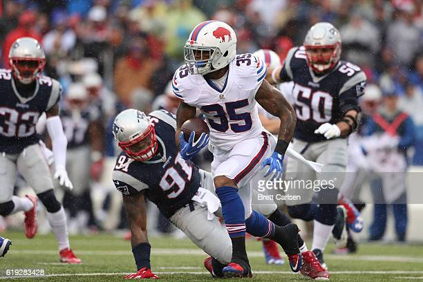 Mike Gillislee of the Buffalo Bills runs the ball against the New England Patriots during the first half at New Era Field on October 30, 2016 in...