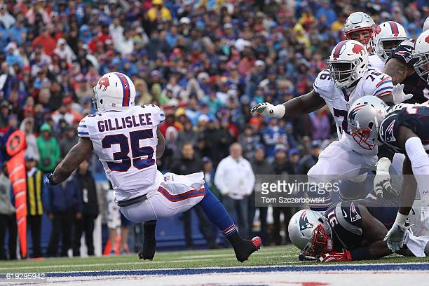 Mike Gillislee of the Buffalo Bills scores a touchdown against the New England Patriots during the first half at New Era Field on October 30, 2016 in...