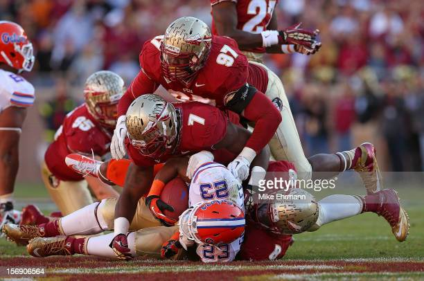 Mike Gillislee of the Florida Gators is tackled during a game against the Florida Gators at Doak Campbell Stadium on November 24 2012 in Tallahassee...