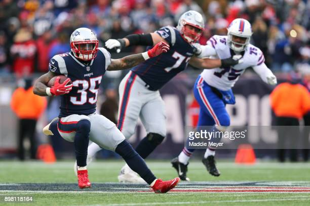 Mike Gillislee of the New England Patriots carries the ball against the Buffalo Bills during the second half at Gillette Stadium on December 24, 2017...