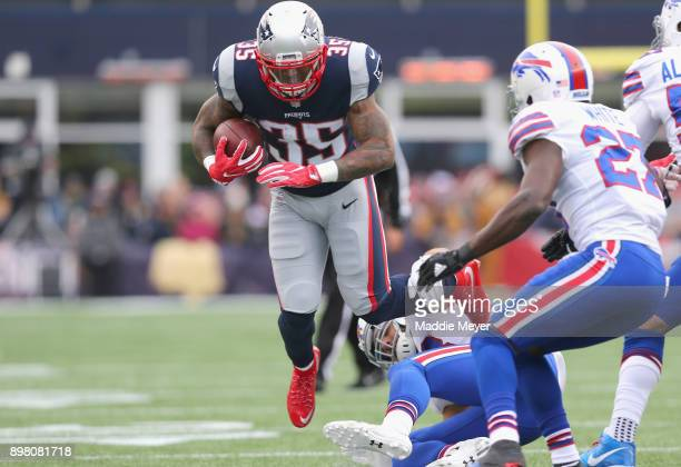 Mike Gillislee of the New England Patriots carries the ball during the first quarter of a game against the Buffalo Bills at Gillette Stadium on...
