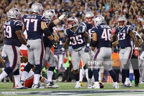 Mike Gillislee of the New England Patriots celebrates with teammates after scoring a touchdown during the second quarter against the Kansas City...