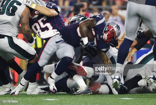 Mike Gillislee of the New England Patriots is tackled by the Philadelphia Eagles defense as he carries the ball in the first half during the...