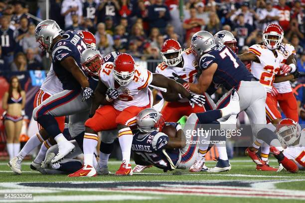 Mike Gillislee of the New England Patriots rushes for a 1yard touchdown during the third quarter against the Kansas City Chiefs at Gillette Stadium...