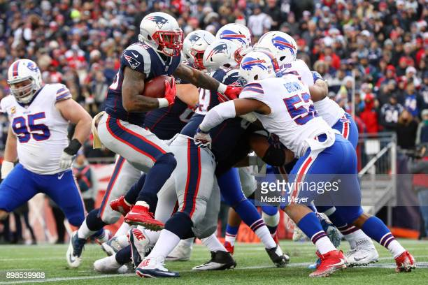 Mike Gillislee of the New England Patriots scores a touchdown against the Buffalo Bills at Gillette Stadium on December 24, 2017 in Foxboro,...