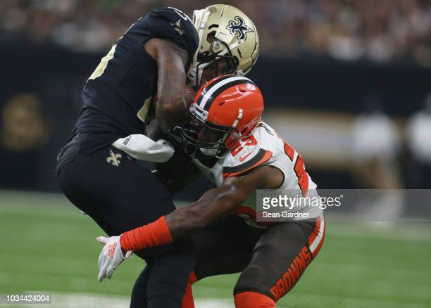 Mike Gillislee of the New Orleans Saints is tackled by Damarious Randall of the Cleveland Browns during the second quarter at Mercedes-Benz Superdome...