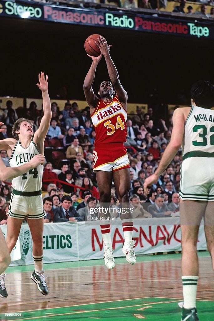 Mike Glenn #34 of the Atlanta Hawks shoots a jump shot against the Boston Celtics during a game played in 1983 at the Boston Garden in Boston, Massachusetts.