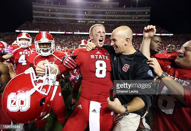 Mike Glennon of the North Carolina State Wolfpack celebrates after defeating the Florida State Seminoles 1716 after their game at CarterFinley...