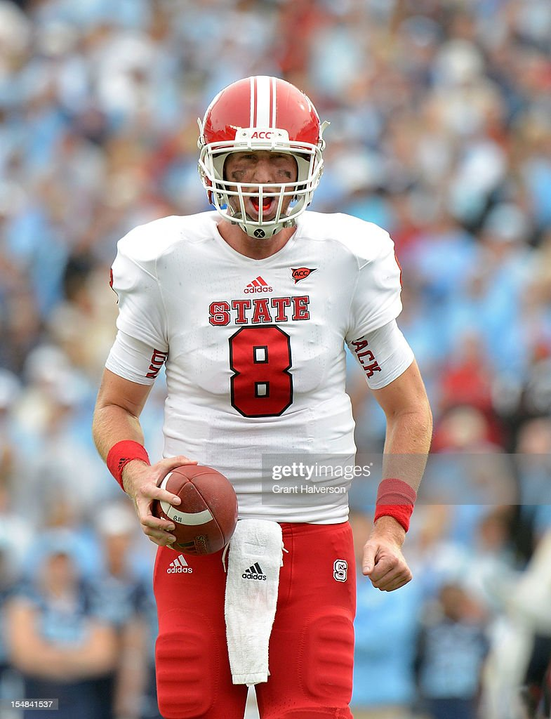 Mike Glennon #8 of the North Carolina State Wolfpack reacts after a false start penalty was called against the offense during play against the North Carolina Tar Heels at Kenan Stadium on October 27, 2012 in Chapel Hill, North Carolina. North Carolina won 43-35.