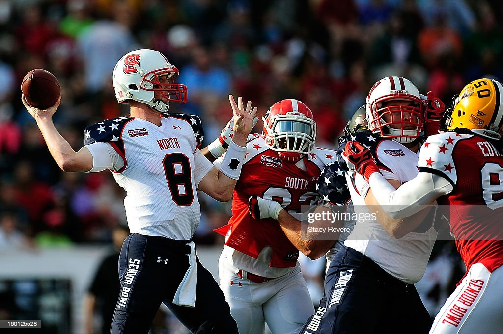 Mike Glennon #8 of the North squad drops back to pass against the South squad during the Senior Bowl at Ladd Peebles Stadium on January 26, 2013 in Mobile, Alabama. The South won the game 21-16.