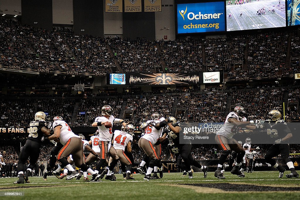 Mike Glennon #8 of the Tampa Bay Buccaneers drops back to pass against the New Orleans Saints during a game at the Mercedes-Benz Superdome on December 29, 2013 in New Orleans, Louisiana. New Orleans won the game 42-17.