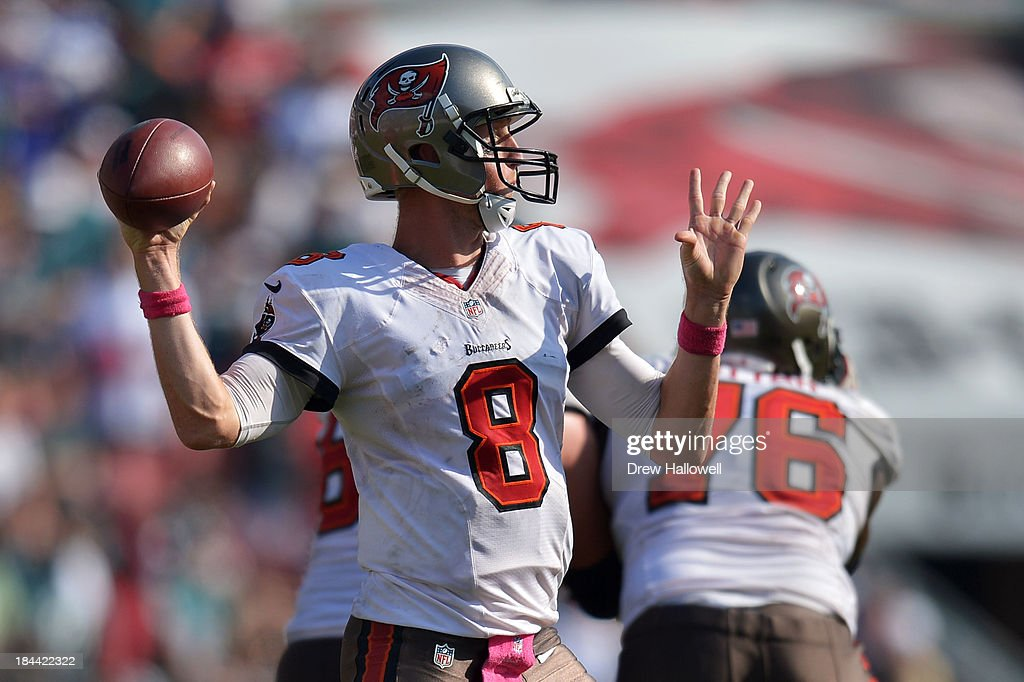 Mike Glennon #8 of the Tampa Bay Buccaneers passes against the Philadelphia Eagles at Raymond James Stadium on October 13, 2013 in Tampa, Florida. The Eagles won 30-21.