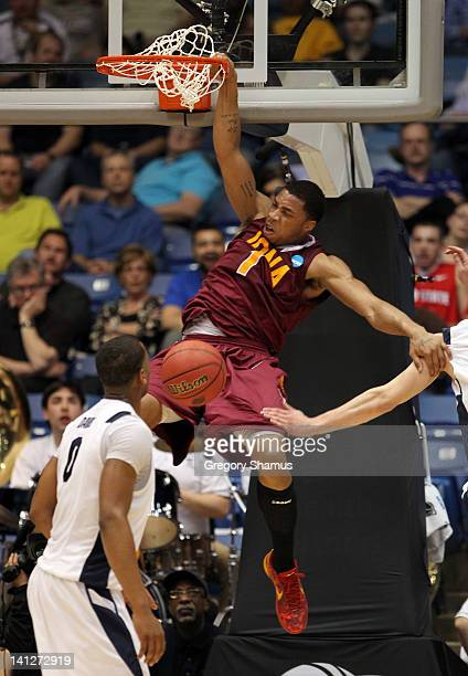 Mike Glover of the Iona Gaels dunks the ball in the first half while taking on the Brigham Young Cougars in the first round of the 2011 NCAA men's...