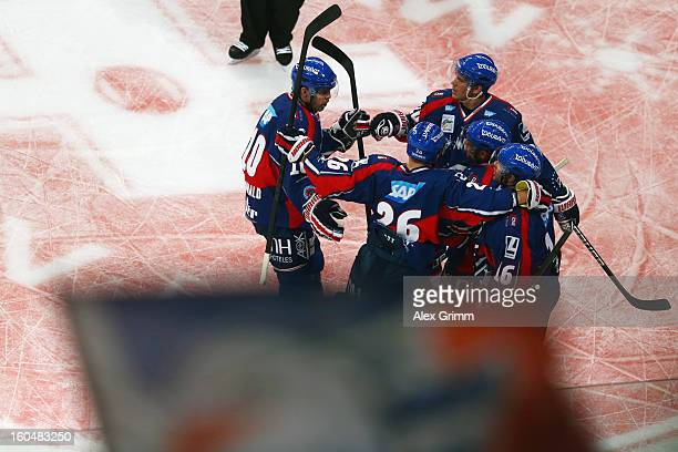 Mike Glumac of Mannheim celebrates his team's first goal with team mates during the DEL match between Adler Mannheim and Eisbaeren Berlin at SAP...