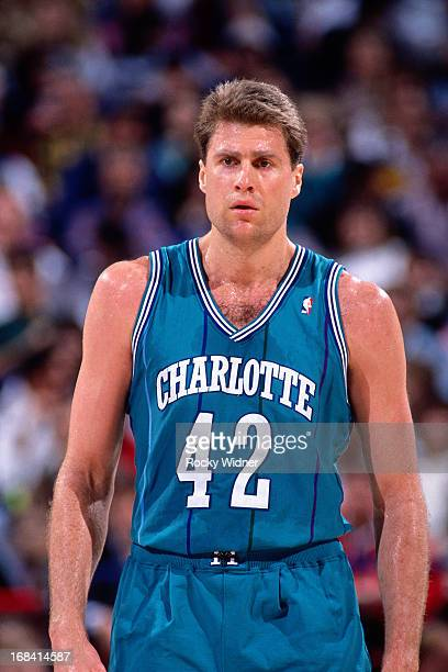 Mike Gminski of the Charlotte Hornets looks on against the Sacramento Kings during a game played on February 27 1991 at Arco Arena in Sacramento...