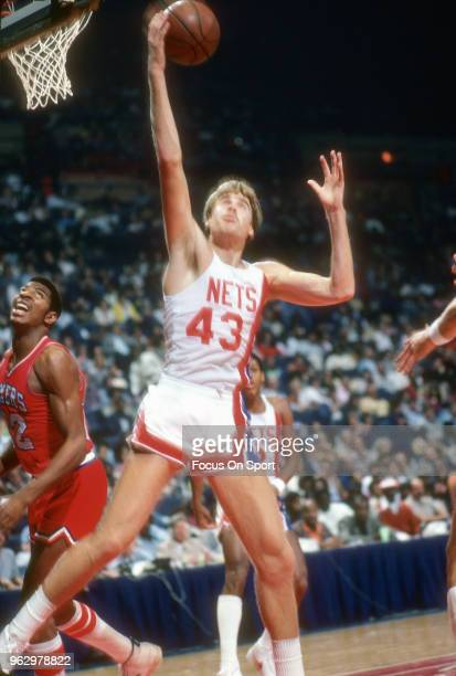 Mike Gminski of the New Jersey Nets grabs a rebound against the Philadelphia 76ers during an NBA basketball game circa 1981 at the Capital Centre in...