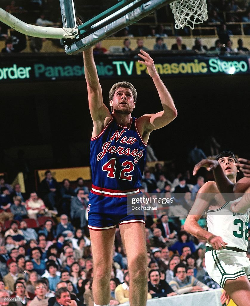 Mike Gminski #42 of the New Jersey Nets shoots against the Boston Celtics during a game played in 1983 at the Boston Garden in Boston, Massachusetts.
