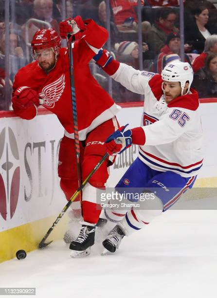 Mike Green of the Detroit Red Wings battles for the puck with Andrew Shaw of the Montreal Canadiens during the first period at Little Caesars Arena...