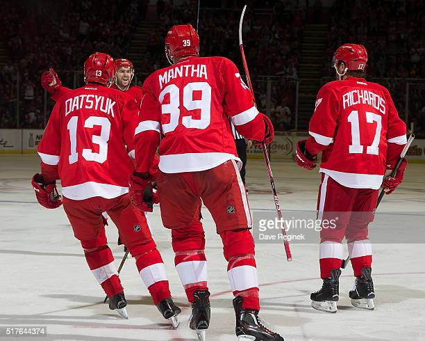 Mike Green of the Detroit Red Wings celebrates his goal with teammates Pavel Datsyuk Anthony Mantha and Brad Richards during the third period of an...