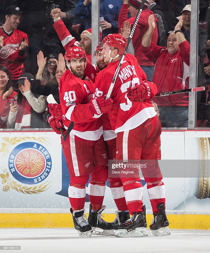 Mike Green #25 of the Detroit Red Wings celebrates his third period goal with teammates Henrik Zetterberg #40 and Anthony Mantha #39 during an NHL game against the Pittsburgh Penguins at Joe Louis Arena on January 14, 2017 in Detroit, Michigan. The Wings defeated the Penguins 6-3.