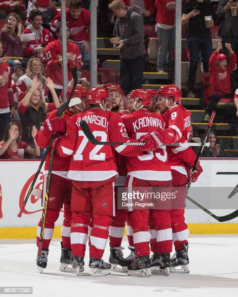 Mike Green of the Detroit Red Wings celebrates his third period goal with teammates Andreas Athanasiou Niklas Kronwall and Justin Abdelkader during...