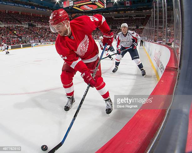 Mike Green of the Detroit Red Wings controls the puck in the corner in front of John Carlson of the Washington Capitals during an NHL game at Joe...
