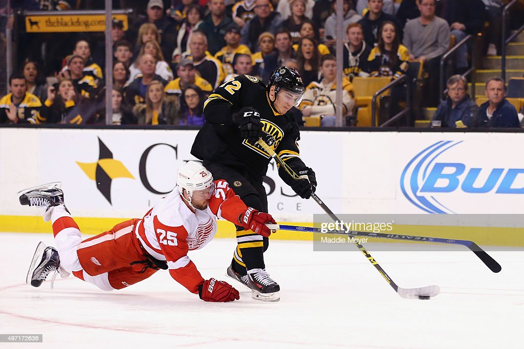 Mike Green #25 of the Detroit Red Wings dives to defend Frank Vatrano #72 of the Boston Bruins during the first period at TD Garden on November 14, 2015 in Boston, Massachusetts.