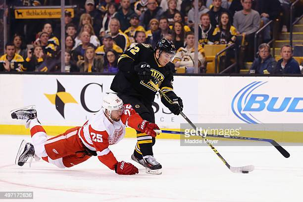 Mike Green of the Detroit Red Wings dives to defend Frank Vatrano of the Boston Bruins during the first period at TD Garden on November 14 2015 in...