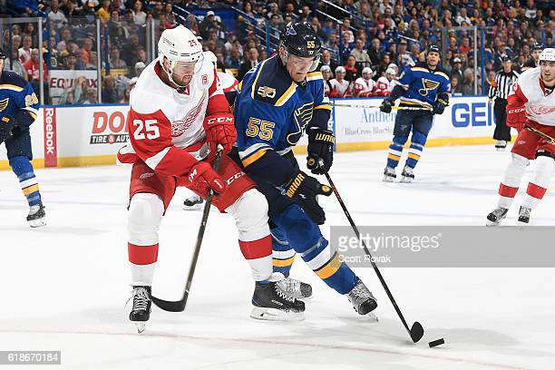 Mike Green of the Detroit Red Wings fights Colton Parayko of the St Louis Blues for control of the puck in the second period on October 27 2016 at...