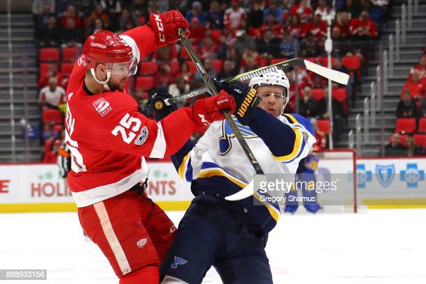 Mike Green of the Detroit Red Wings lays a first period hit on Carl Gunnarsson of the St Louis Blues at Little Caesars Arena on December 9 2017 in...